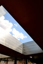 Clouds through the cutout at the museum and national art center reina sofía modern steel glass upper patio of in madrid spain Stock Photography