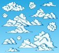 Clouds drawings on blue sky Stock Photos