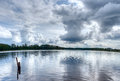 Clouds lake water reflections Royalty Free Stock Photos