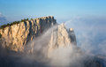 Clouds move below rocks on the mountain ai petri crimea Royalty Free Stock Images