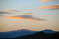 Clouds over hills at sunset silhouettes of Royalty Free Stock Photo