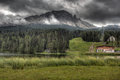 Clouds over lake Misurina, Dolomites, Italy. Royalty Free Stock Photo