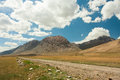 Clouds over a mountain road on a clear day in central asia Stock Photography
