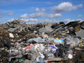 Clouds over Trash Stock Images