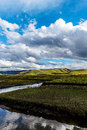 Clouds on the prairie river. Royalty Free Stock Photo