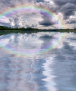 Clouds rainbow lake landscape Royalty Free Stock Photo