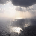 Clouds and rays of sun above the sea Stock Photography