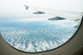 Clouds and sky as seen through window of an aircraft Royalty Free Stock Photos