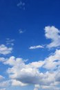 Clouds in the sky drifting away a light breeze Stock Images