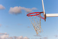 Clouds in the sky fly into a basketball hoop on blue red on sunny summer day Stock Photos