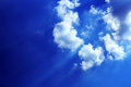 Clouds in the sky nice background with blue and sunbeams across Royalty Free Stock Images