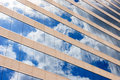 Clouds and sky reflection in the windows of modern office building Stock Photography
