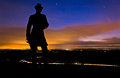 Clouds and stars moving behind a statue in a long exposure taken at night from little round top in gettysburg pennsylvania Stock Images
