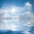 Clouds and sun reflection in water Royalty Free Stock Photo