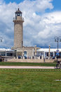 Cloudscape with Lighthouse in Patras, Peloponnese, Greece Royalty Free Stock Photo