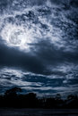 Cloudscape. Nightly sky with bright full moon. Outdoors at night Royalty Free Stock Photo