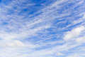Cloudscape over blue sky on a sunny day Stock Photos