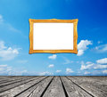 Cloudscape on wall with golden frame Stock Image