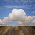 Cloudy blue sky and a wooden floor background image Royalty Free Stock Images