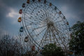 Cloudy days to suspend the ferris wheel under dark clouds suspended lonely Stock Photography