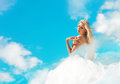 Cloudy lady in the blue sky beautiful blond woman clouds throwing back her head Royalty Free Stock Photos