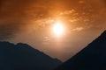 Cloudy orange mountain sunset Royalty Free Stock Photo