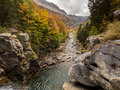 Cloudy and rocky canyon in autumn Royalty Free Stock Photo