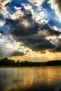 Cloudy sky above lake Stock Photography