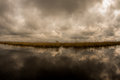Cloudy sky grey stormy and autumn in the danube delta Royalty Free Stock Images
