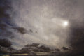Cloudy sky a mystical sun against a gray cloud Royalty Free Stock Image