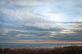 Cloudy sky over baltic sea in gray autumn day Stock Image