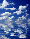 Cloudy sky reflecting in water Stock Photos