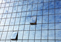Cloudy sky reflection in business building glass Royalty Free Stock Photo