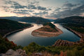 Cloudy sunset at arda river bulgaria the meander of Stock Photos