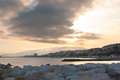 The cloudy sunset cannes seascape on with a breakwater on frontage france Stock Photography