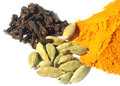 Clove cardamom seeds with powder turmeric over white background Stock Images