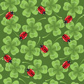 Clover and ladybirds seamless background Royalty Free Stock Photo