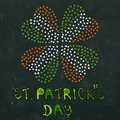 Clover Leaves Heart Shaped Colored in Ireland Flag Colours Green, White, Orange. On a Black Board Background. With St Patricks Day Royalty Free Stock Photo