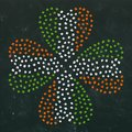 Clover Leaves Heart Shaped Colored in Ireland National Flag Colours Green, White, Orange. On a Black Board Background. St Patricks Royalty Free Stock Photo