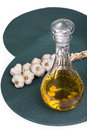Cloves garlic oil carafe Royalty Free Stock Photo
