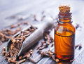 Cloves and oil Royalty Free Stock Photo