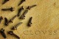 Cloves on a wood background Royalty Free Stock Images