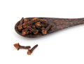 Cloves on a wooden spoon Royalty Free Stock Photos