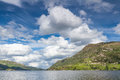 Clowds over ullswater white clouds the second biggest lake in the lake district uk Stock Image