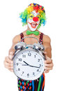 Clown with alarm clock on white Stock Photo