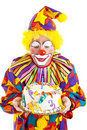 Clown Blows Birthday Candle Stock Images