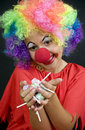 Clown with Candy Royalty Free Stock Photography