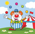 Clown cartoon character juggling with balls in front of circus tent funny Royalty Free Stock Photo
