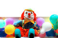 Clown between coloured balloons Royalty Free Stock Photo