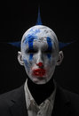 Clown crazy zombies blue in a jacket studio Stock Photo